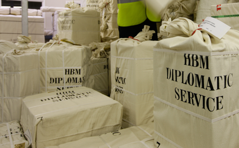 Photo of diplomatic bags. They are different sizes, in cream sacks, with HBM Diplomatic Service printed on them.
