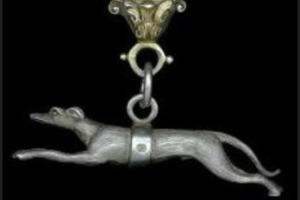 Photo of silver greyhound figurine hanging from the Badge of Office.